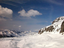 Alpine slopes. Covered with delicious creamy snow Stock Photos