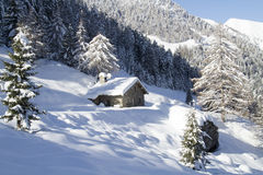 Alpine snow-covered hut Royalty Free Stock Photos
