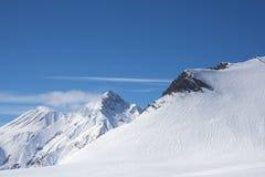 Alpine snow-covered rocks bright winter day. stock photos