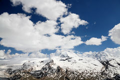 Alpine snowy mountains Royalty Free Stock Image