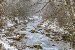 Alpine stream at winter time. Alpine stream seen in the Berchtesgadener Land in Bavaria, Germany, at winter time stock photo