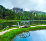 Alpine summer lake and sunshine through cloudy sky Royalty Free Stock Images