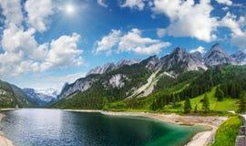 Alpine summer lake sunshiny panorama. Beautiful summer Alpine lake Gosausee  sunshiny view Austria. Two shots stitch panorama Stock Photography