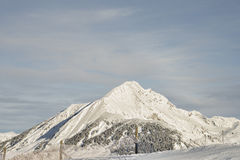 Alpine summit view from slope of ski resort Stock Images