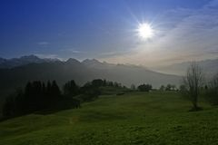 Alpine sun. View of the Swiss alps: Beautiful horizon цшер mountain ridge,  Interlaken, central Switzerland Royalty Free Stock Photo
