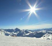 Alpine sun. Winter time sun snow in Alps royalty free stock photo