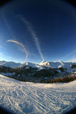 Alpine sunset 1. Fisheye shot of a skiing slope in the alps Royalty Free Stock Images