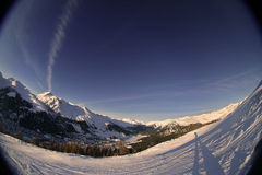Alpine Sunset 2. Fisheye shot of a skiing slope in the alps Stock Photo