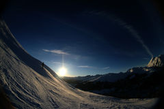 Alpine sunset 4. Fisheye shot of a skiing slope in the alps Stock Images