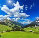 Alpine sunshiny view Vorarlberg,Austria. Summer mountain  sunshiny view to Biberkopf mount Warth, Vorarlberg, Austria and deep blue sky with clouds Royalty Free Stock Image