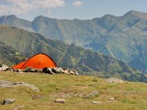Alpine tent in the top of the mountains Stock Photo