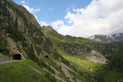Alpine tunell. View in alpine mountain pass in Switzerland royalty free stock photography