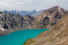 Alpine turquoise lake Ala-Kul, Tien Shan mountains Stock Photo