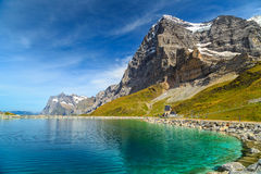 Alpine turquoise lake and Eiger North face,Bernese Oberland,Switzerland Stock Photos