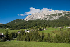 Alpine Valley. A grassy alpine valley in the Dolomite mountains of Italy Royalty Free Stock Photo