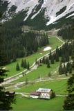 Alpine Valley. Mountain Hut in steep Alpine Valley Stock Photos