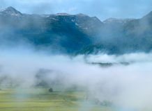 Alpine valley in the morning mist,above Lake Bohinj. Slovenia Stock Photos