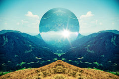 Alpine Valley and Mountains with Sunny Sphere Royalty Free Stock Images