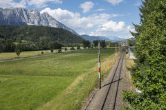 Alpine valley. With railroad track stock photography