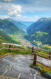 Alpine valley view from peak. Royalty Free Stock Photography