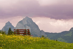 Alpine view. The mythen peaks rising from a picturesque landscape of fields and sky Stock Photo