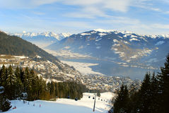 Alpine view to Zell am See. Winter mountain landscape with an alpine ski resort Zell an See and a lake Stock Image