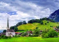 Alpine village. Alpine landscape with a church, near Innsbruck in Austria stock photos