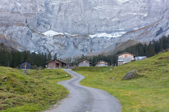 Alpine village. At the end of the valley with cliffs behind, near Unterschaechen and Klausepass, late autumn, Swiss Alps Royalty Free Stock Photography