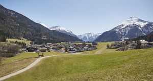 Alpine village in the Austrian Alps - Stock Photo. A Alpine village in the Austrian Alps with snowy mountains in the background Stock Photos