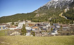 Alpine village in the Austrian Alps - Stock Photo. A Alpine village in the Austrian Alps with snowy mountains in the background Stock Photography