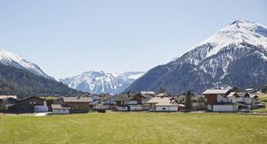 Alpine village in the Austrian Alps - Stock Photo. A Alpine village in the Austrian Alps with snowy mountains in the background Royalty Free Stock Photo