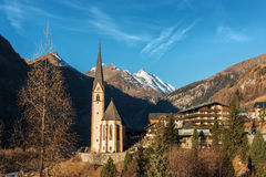 Alpine village with beautiful pilgrimage church and blue sky stock images