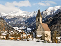 Alpine village. The church of a small alpine village near Vipiteno, north of Italy Stock Photography
