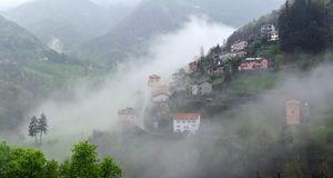 Alpine village in cloudy weather Royalty Free Stock Images