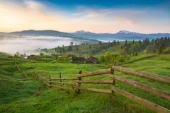Alpine village covered with fresh spring grass Royalty Free Stock Image