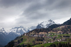 Alpine village in Dolomites mountains at cloudy day Royalty Free Stock Photo