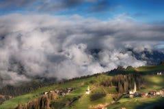 Alpine village in Dolomites mountains Royalty Free Stock Photo