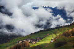 Alpine village in Dolomites mountains Royalty Free Stock Images
