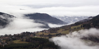 Alpine village in the fog. France, rhone-Alpes Stock Photos