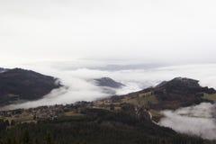 Alpine village in the fog. France, rhone-Alpes Royalty Free Stock Photo