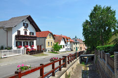 Alpine village Hohe Wand Stollhof. Lower Austria. View of the residential houses and dry water canal in the alpine municipality Hohe Wand Stollhof. Lower Austria Stock Photos