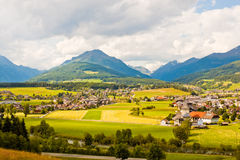 Alpine village and meadows Royalty Free Stock Photography