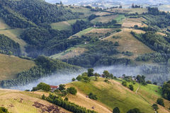 Alpine village in mountains. Smoke, and haze over the hills in Carpathians. Alpine village in mountains. Smoke, and haze over the hills in Carpathians, Romania Stock Photo