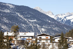 Alpine village in the snow Stock Photography