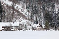 Alpine village at snow winter Stock Images