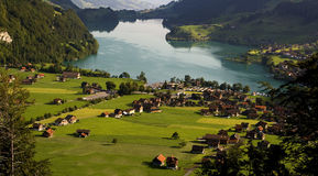Alpine village - Switzerland. View from above of a village by lake royalty free stock photo