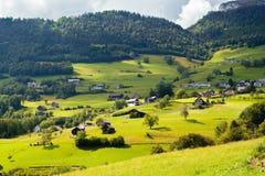 Alpine village in Switzerland. Alpine village in a green valley in Switzerland Stock Photos