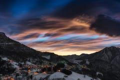 Alpine village winter after sunset Royalty Free Stock Photos