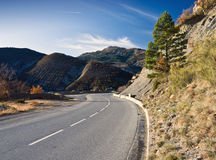 Alpine winding road. France. Alpine winding road with Mountains at background Royalty Free Stock Photo