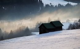 Alpine winter countryside in evening sunlight Stock Photography